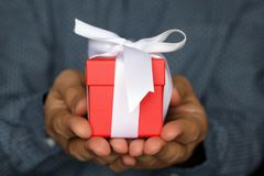 Gift box in male hands close up royalty free stock photography