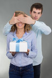 Man giving a present to girlfriend Royalty Free Stock Photos
