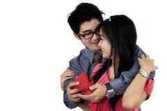 Man giving present to girlfriend Royalty Free Stock Photos