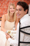 Man giving present to girlfriend Stock Image
