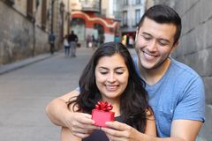Man giving a present to a gorgeous woman royalty free stock image