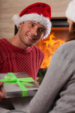 Man giving a present to her girlfriend Stock Photo