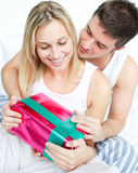 Man giving a present to his girlfriend Royalty Free Stock Photo