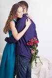 Man giving present to his girlfriend. Young men giving present to his girlfriend Royalty Free Stock Photography