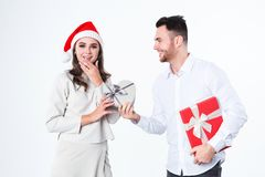Man giving present to his girlfriend. Christmas gifts. Isolated Stock Images