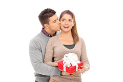 Man giving a present to his girlfriend and kissing her Stock Photography