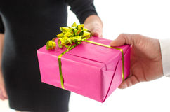 Man giving a present to a woman Royalty Free Stock Photography