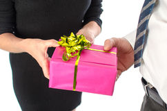 Man giving a present to a woman Royalty Free Stock Image