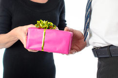 Man giving a present to a woman Stock Images