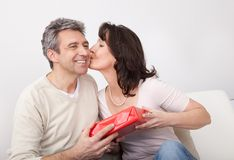 Man giving a present to woman Stock Images