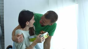 Man giving present to woman on Valentine`s Day stock video footage