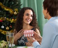 Man giving present to woman stock images