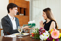 Man giving present to young woman Stock Images