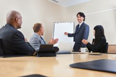 Man giving a presentation to associates royalty free stock photo
