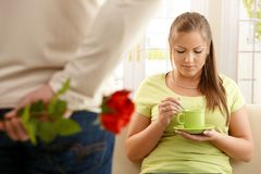 Man giving red rose to woman Royalty Free Stock Images