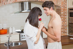 Man giving red rose to woman Royalty Free Stock Image