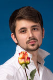 Man giving the red roses. Close up portrait. Royalty Free Stock Images