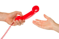 Man giving red telephone to woman Stock Photo