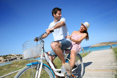 Man giving ride to his girlfriend on bicycle Royalty Free Stock Photo