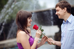 Man giving rose to a girl Royalty Free Stock Images
