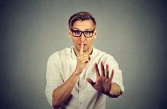 Man giving Shhhh quiet, silence, secret gesture Stock Image