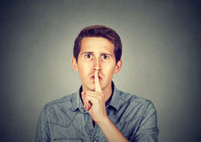 Man giving Shhhh quiet, silence, secret gesture Royalty Free Stock Image