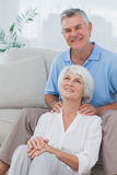 Man giving shoulder massage to wife Stock Photography