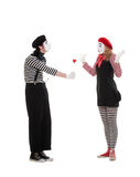Man giving small red heart to woman Stock Images