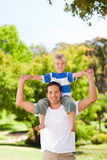 Man giving son a piggyback Royalty Free Stock Photos