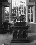 Man giving a speech at a pulpit Stock Images