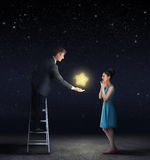 Man giving a star from the sky to a woman Stock Images
