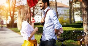 Man giving surprise gift as present to his lovely girlfriend. He is dating Stock Photos