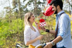 Man giving surprise gift as present to his lovely girlfriend. He is dating Stock Photo