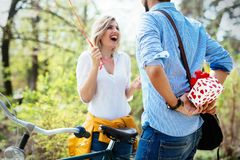 Man giving surprise gift as present to his lovely girlfriend. He is dating Stock Image
