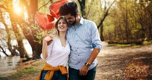 Man giving surprise gift as present to his lovely girlfriend. He is dating Royalty Free Stock Photo