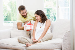 Man giving a surprise gift to her woman Royalty Free Stock Photo