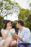 Man giving a surprise gift to woman Royalty Free Stock Images