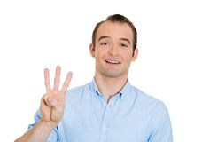 Man giving three fingers Stock Image