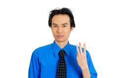 Man giving three fingers sign Stock Photos