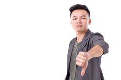 Man giving thumb down,  looking at you Royalty Free Stock Photos