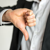 Man giving a thumbs down gesture of disapproval Stock Images