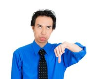 Man giving thumbs down and tongue out Stock Photography