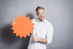 Man giving thumbs up at blank panel. Royalty Free Stock Photo