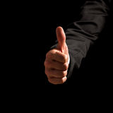 Man giving a thumbs up gesture Stock Images