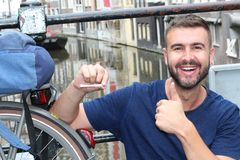 Man Giving Thumbs-up Holding Joint In Amsterdam Stock Photos