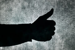 Man giving a thumbs-up sign Stock Photo
