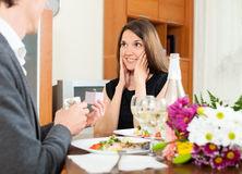Man giving to girl the jewel box  at home Stock Image