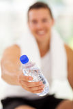 Man giving water bottle Stock Images