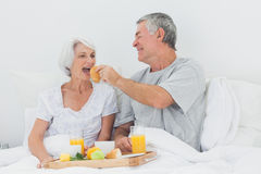 Man giving wife a croissant to wife Royalty Free Stock Photo