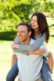 Man giving wife a piggyback Stock Photo